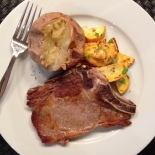 Veal Chop with Baked Potato and yellow zucchini