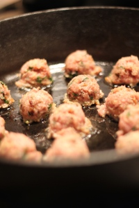 Pan frying the meatballs in cast iron skillet