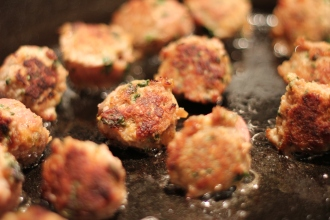 Browning Meatballs in Cast Iron Pan