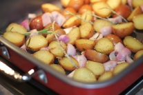 Mini Potatoes, Shallots and Rosemary in Circulon® Roaster